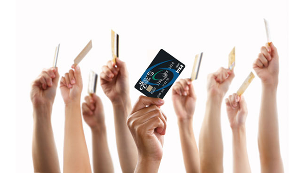 Hands holding debit cards on a white background