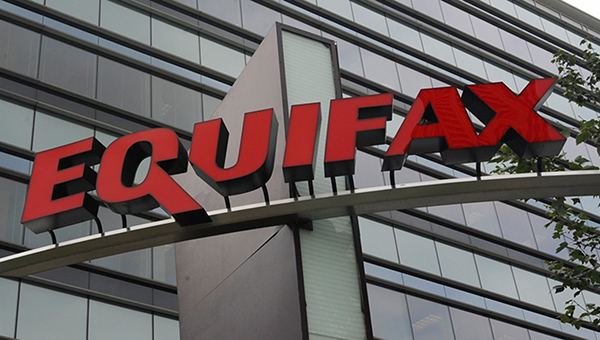 Equifax logo in front of their corporate headquarters
