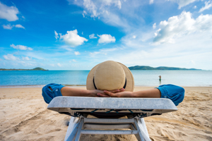 SCU Member relaxes after savings for their vacation with a holiday account.