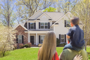 Mortgage-Family-Looking-at-House