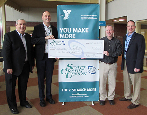 SCU representatives present a check for $5,000 to the Gateway Region YMCA